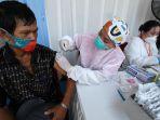 unilever-gelar-vaksinasi-covid-19-bagi-pemulung_20210906_001447.jpg
