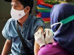 vaksinasi-covid-19-tahap-ketiga-sasar-rw-kumuh-di-dki-jakarta_20210520_194824.jpg
