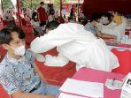 vaksinasi-massal-untuk-pelajar-di-sma-n-1-semarang_20210714_131000.jpg