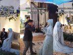 viral-aksi-pengantin-wanita-mendadak-jadi-fotografer.jpg