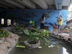 Setelah Dikunjungi Risma, Kolong Jembatan Menteng Disulap Jadi Taman dan Kolam Ikan