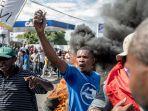warga-haiti-berdemonstrasi-di-port-au-prince.jpg