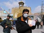 warga-iran-kenakan-masker-saat-pemilihan-parlemen_20200222_011757.jpg
