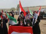 warga-palestina-bawa-bendera-indonesia_20180402_191532.jpg