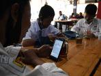 warkop-pitulikur-fasilitasi-siswa-belajar-daring-dengan-wifi-gra_20200720_172018.jpg