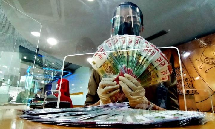 Persiapan Uang Tunai Jelang Lebaran