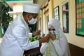 akad-nikah-dengan-protokol-kesehatan-di-kua-pondok-aren_20200607_050009.jpg