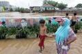 banjir-rendam-jalan-jatinegara-barat_20210208_205921.jpg