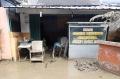 bersih-bersih-usai-banjir-bandang_20200102_210414.jpg