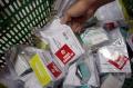 Distribusi Paket Obat Gratis untuk Pasien Covid-19 Isolasi Mandiri