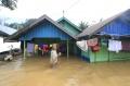 Evakuasi Korban Banjir di Bantaran Sungai Tuan Kalsel