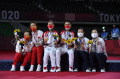 greysia-polli-dan-apriyani-rahayu-raih-emas-olimpiade-badminton_20210802_190611.jpg
