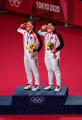 greysia-polli-dan-apriyani-rahayu-raih-emas-olimpiade-tokyo-2020_20210802_192337.jpg
