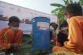 hut-jmi-ke-4-adakan-donasi-pendidikan-untuk-siswa-anak-nelayan_20211018_130542.jpg