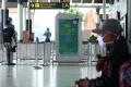 jumlah-penumpang-pesawat-menurun-akibat-pandemi-corona_20200327_213646.jpg