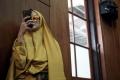 mulan-jameela-dengan-setia-temani-ahmad-dhani-dalam-persidangan_20190305_201208.jpg