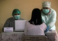 pedagang-pasar-melong-disuntik-vaksin-covid-19_20210225_191654.jpg