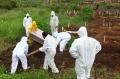 pemakaman-jenazah-korban-covid-19-di-tpu-cikadut-kota-bandung_20210202_125514.jpg