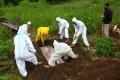 pemakaman-jenazah-korban-covid-19-di-tpu-cikadut-kota-bandung_20210202_130513.jpg