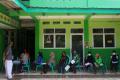 pembagian-bantuan-sosial-tunai_20210725_184703.jpg