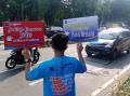 Peringati Harkonas Relawan Lakukan Kampanye Vaksin Covid-19