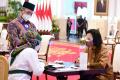presiden-jokowi-wapres-dan-sejumlah-menteri-serahkan-zakat_20210415_222141.jpg