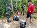 satgas-pamtas-ri-malaysia-yonif-642-amankan-pmi-non-prosedural_20210301_120054.jpg