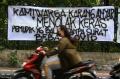 Spanduk Peringatan untuk Pemudik yang Kembali ke Jakarta