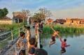 sungai-di-desa-purwosari-tempat-favorit-anak-anak-bermain_20201022_195133.jpg