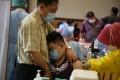 suntik-vaksin-covid-19-lembaga-keagamaan-palembang_20210324_161150.jpg