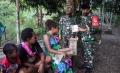 TNI Berbagi Tali Asih pada Hari Raya Iedul Fitri 1442 H di Kampung Mosso Papua