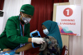 vaksinasi-covid-19-kedua-bagi-pelaku-usaha_20210602_222307.jpg