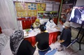 vaksinasi-massal-covid-19-di-kampung-tangguh-cideng_20210411_082714.jpg