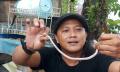 warga-berhasil-mengamankan-anak-ular-kobra-albino-di-tangerang_20211015_202521.jpg