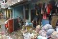 warga-cipinang-bersih-bersih-usai-terkena-bencana-banjir_20210222_182838.jpg