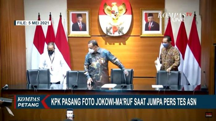 Foto Presiden Joko Widodo dan Wakil Presiden Maruf Amin terpasang pada salah satu dinding ruangan berdampingan dengan logo KPK.