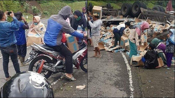 Warga-punguti-muatan-minuman-dari-truk-kecelakaan.jpg