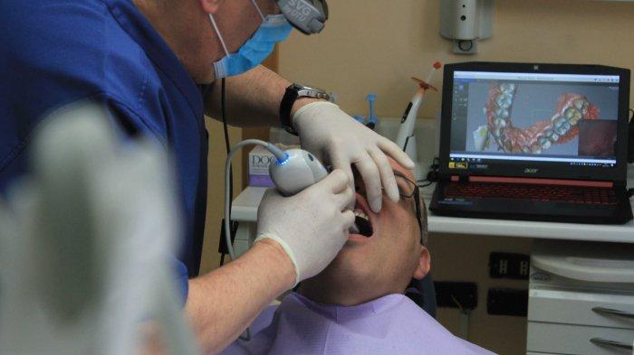 ilustrasi-praktik-dokter-gigi-1.jpg