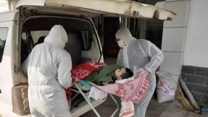ILUSTRASI - Pejabat di provinsi Hubei melakukan penyelidikan setelah seorang remaja meninggal ketika dia ditinggalkan di rumah sementara orang tuanya diisolasi karena dicurigai telah menangkap virus corona Wuhan.(Weixin/South China Morning Post)