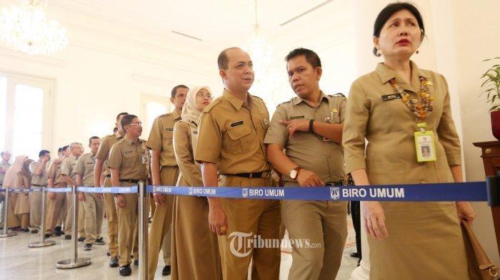 Ilustrasi PNS- Sejumlah Pegawai Negeri Sipil (PNS) saat mengikutii acara halal bihalal dengan sejumlah Pegawai Negeri Sipil (PNS) di Gedung Balaikota, Jakarta Pusat, Senin (10/6/2019).