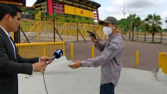 seorang-reporter-tv-dirampok-saat-siaran-langsung-di-televisi.jpg