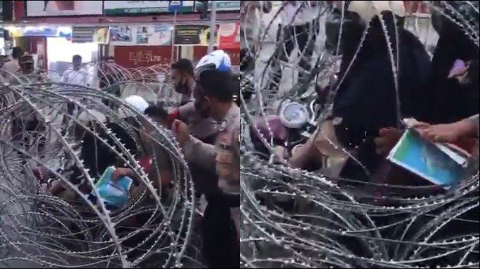 viral-pengendara-motor-tersangkut-kawat-barikade.jpg