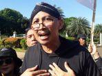 Penuhi Panggilan Polisi, Abu Janda Datangi Bareskrim Polri Tanpa Lewat Pintu Utama