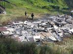 Rumah-guru-yang-dibakar-KKB-di-Kampung-Dambet-Distrik-Beoga.jpg