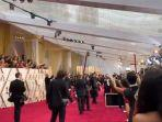 Hujan Lebat Membuat Atap Plastik Red Carpet Oscar 2020 Tergenang Air dan Hampir Bocor