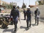 pasukan-keamanan-palestina-berpatroli-di-sebuah-jalan-di-balatah-al-balad.jpg