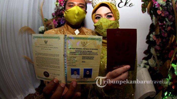 FOTO : Pernikahan Pasangan Pengantin di Tengah Pandemi Covid-19 di Pekanbaru - pernikahan-saat-pandemi-covid1.jpg