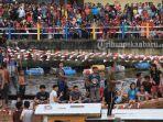 ribuan-masyarakat-pekanbaru-tumpah-ruah-di-sekitar-sungai-siak-untuk-mengikuti-tradisi-petang-megang.jpg