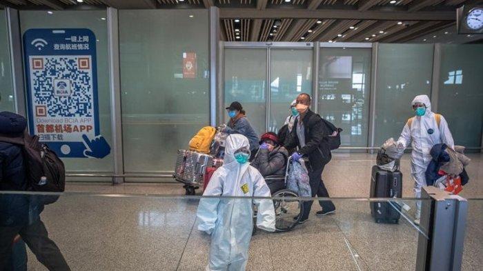 Pandemi Virus Corona, Kini China Larang Kedatangan Turis Asing