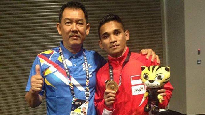 Aldoms Sugoro (kanan) saat meraih medali emas kelas 52 Kg di SEA Games Malaysia 2017 lalu